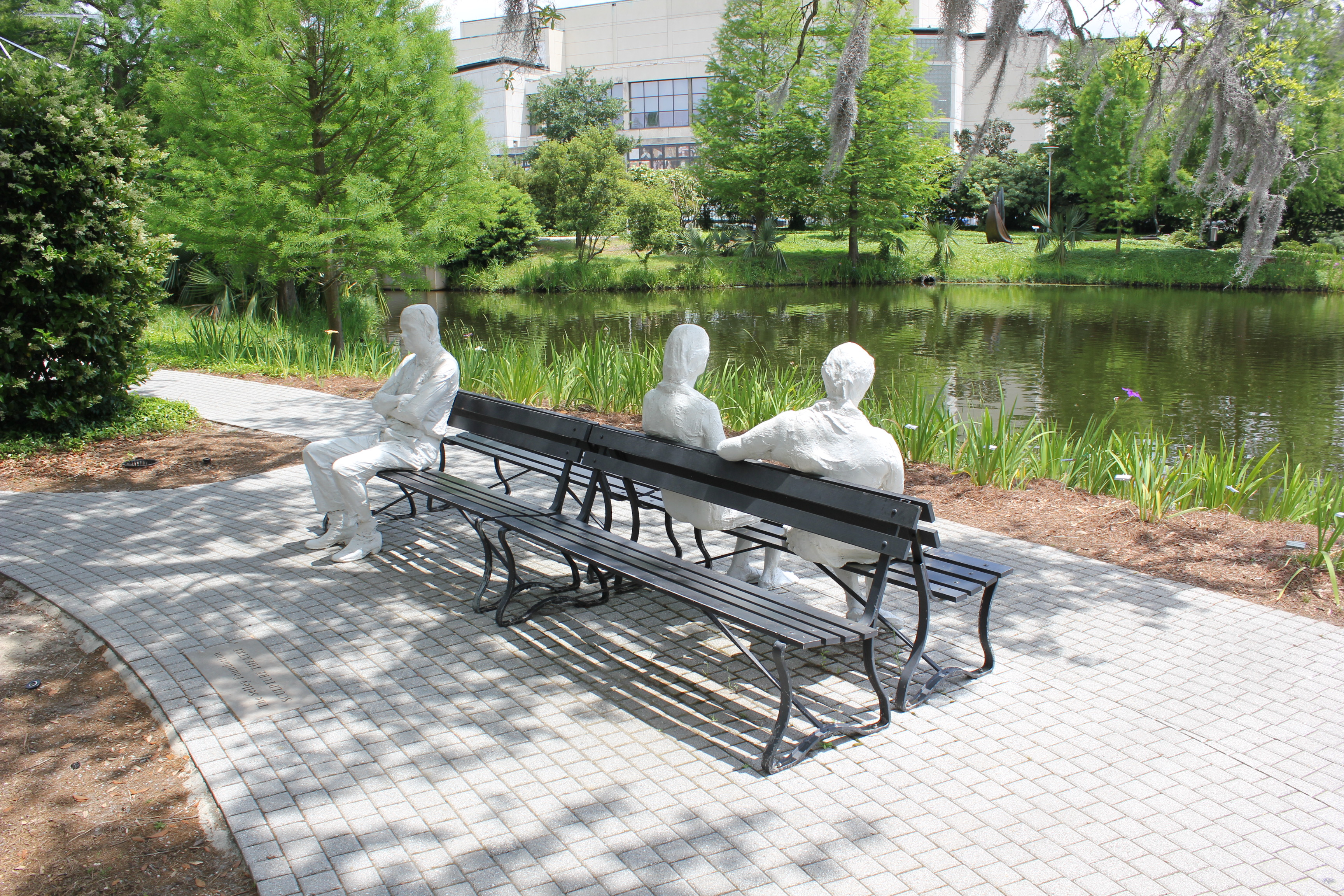 Statues sit on Bench at New Orleans Museum of Art and Sculpture ...