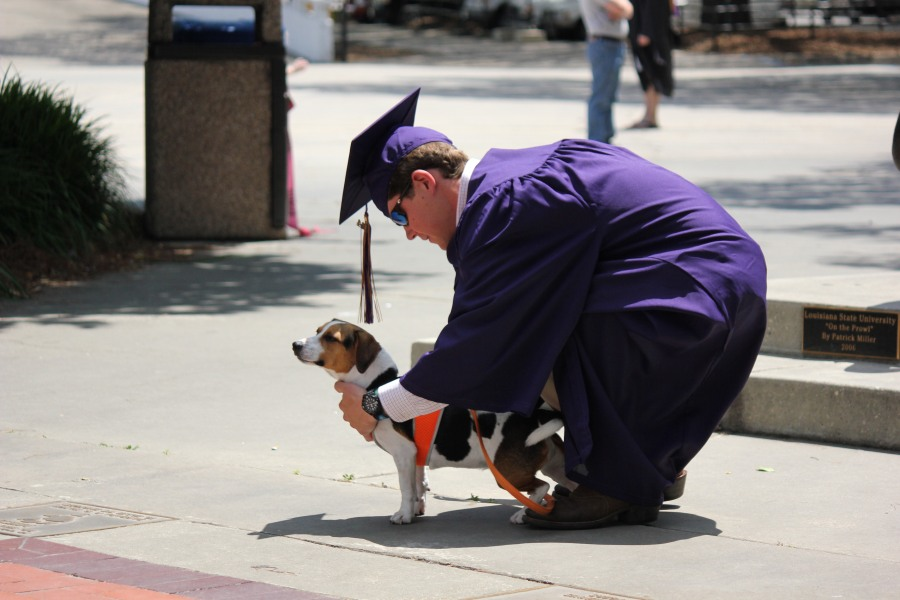 LSU Grad Posing for Pictures with Dog May 17 2014