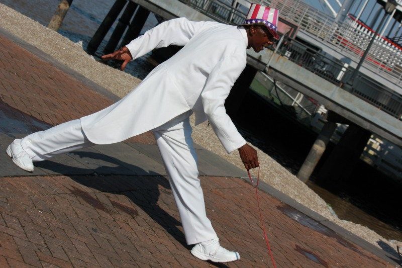 Man in White Suit Frozen in Place in New Olreans